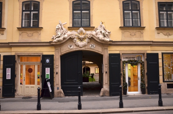 A typical street scene in Vienna, in the Josefstadt district, with a peek inside a courtzard