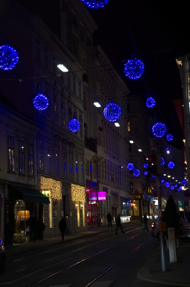 Beautiful blue Christmas lights over a dark street in Vienna