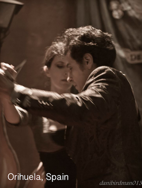 Sepia image of a couple dancing tango in Spain