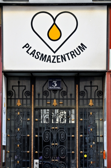 Heart signs for a plasma center in Vienna over a beautiful ornate gate.