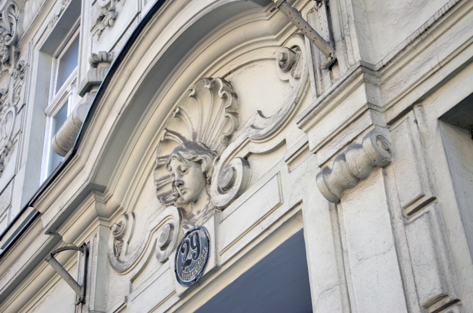 Architectural detail of a woman's face above an entrance in Vienna