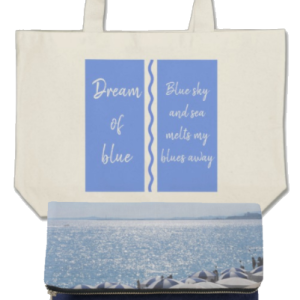 A large pale blue and natural colored beach bag and a purse featuring and imageo of the French Riviera.