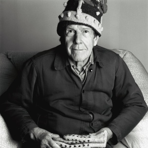 Portrait of John Cage wearing a crown