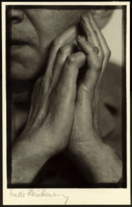 Portrait of writer Karl Kraus, with his hands centered in image